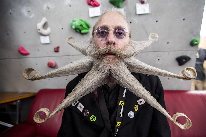 LEOGANG, AUSTRIA - OCTOBER 3: A contestant of the World Beard And Mustache Championships poses for a picture during the Championships 2015 on October 3, 2015 in Leogang, Austria. Over 300 contestants in teams from across the globe have come to compete in sixteen different categories in three groups: mustache, partial beard and full beard. The event takes place every few years at different locations worldwide. (Photo by Jan Hetfleisch/Getty Images)